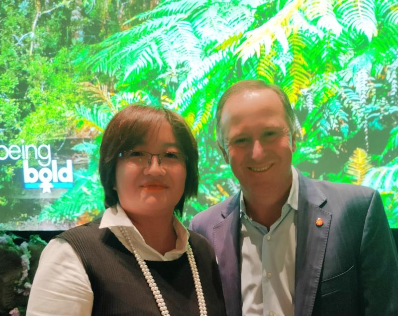 Image of Caroline with Sir John Key